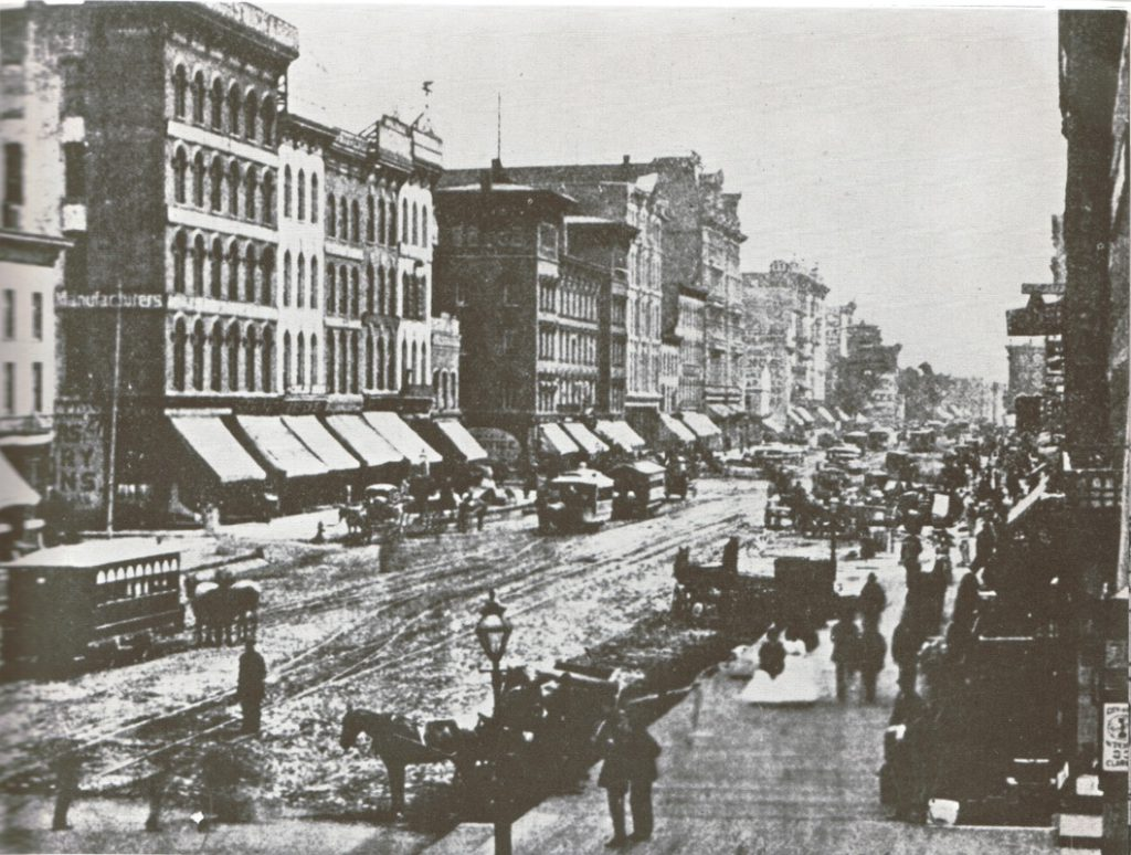 State Street in early 1871 with its characteristic covering of mud. (Source: Kogan & Cromie)